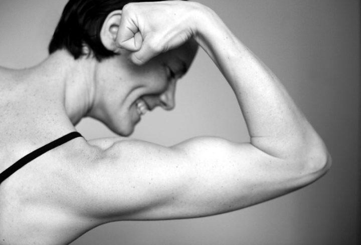 Muskelkraft als Sinnbild für Heizlast oder Heizleistung